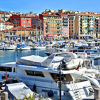 Yachts and Sailboats Moored at Port Lympia in Nice, France <br /> The port of Nice is filled with moored luxury yachts and sailboats.  But sightseeing boats, cruise ships and car ferries also leave from Port Lympia.  Nice welcomes over four million visitors a year and, except for Paris, it has the largest hotel capacity in France.  If you spend a day or two in this French Riviera town, you'll understand why some call it Nice la Belle or Nice the Beautiful.