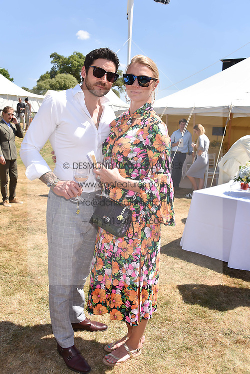 Jodie Kidd and Joseph Bates at the 'Cartier Style et Luxe' enclosure during the Goodwood Festival of Speed, Goodwood House, West Sussex, England. 15 July 2018.