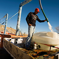 010413     Brian Leddy<br /> D.Y. Yazzie fills a water tank at the Crownpoint Chapter House Friday morning.