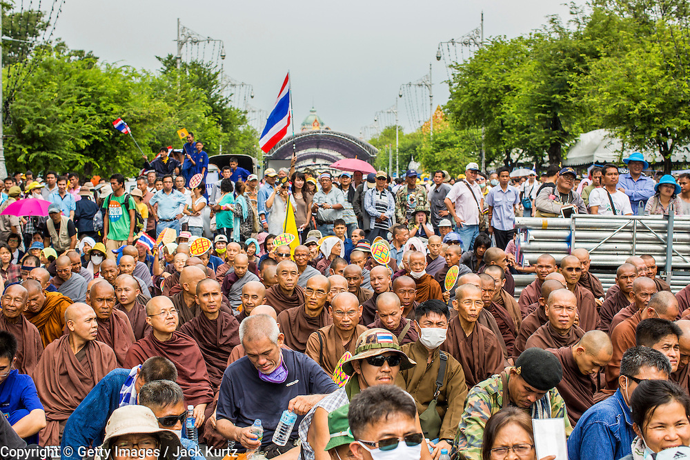 24 NOVEMBER 2012 - BANGKOK, THAILAND:  The crowd, with Buddhist monks in it, during a large anti government, pro-monarchy, protest  on November 24, 2012 in Bangkok, Thailand. The Siam Pitak group, which sponsored the protest, cited alleged government corruption and anti-monarchist elements within the ruling party as grounds for the protest. Police used tear gas and baton charges againt protesters.       PHOTO BY JACK KURTZ
