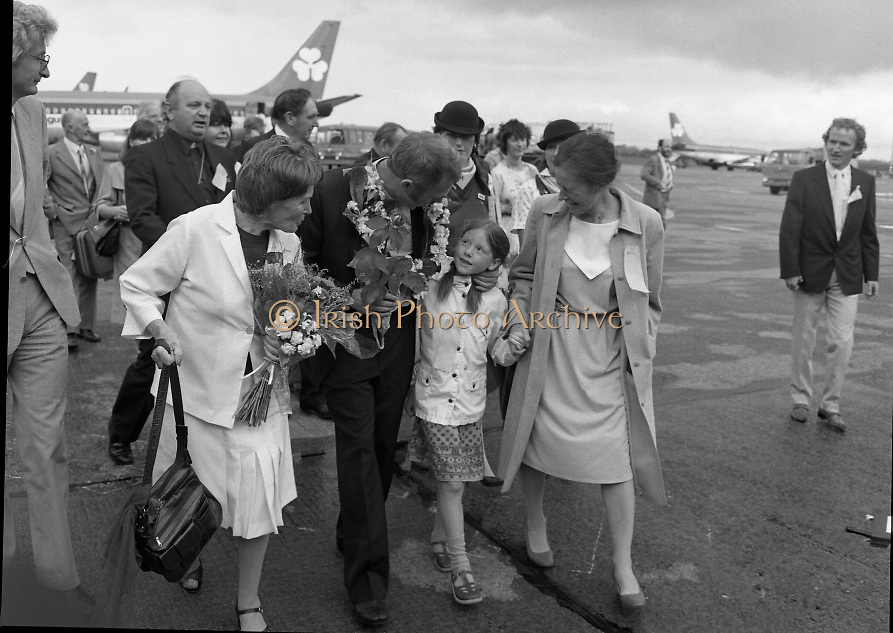 "Fr Niall O'Brien Returns from Captivity.1984..14.07.1984..07.14.1984..On 6 May 1983,Fr Niall O'Brien was arrested along with two other priests, Fr. Brian Gore, an Australian, Fr. Vicente Dangan, a Filipino and six lay workers - the so-called ""Negros Nine"", for the murders of Mayor Pablo Sola of Kabankalan and four companions. The priests where held under house arrest for eight months but ""escaped"" to prison in Bacolod City, the provincial capital, where they felt they would be safer.The case received widespread publicity in Ireland and Australia, the home of one of the co-accused priests, Fr. Brian Gore. When Ronald Reagan visited Ireland in 1984, he was asked on Irish TV how he could help the missionary priest's situation. A phone call the next day from the Reagan administration to Ferdinand Marcos resulted in Marcos offering a pardon to Fr. O'Brien and his co-accused..(Ref Wikipedia)...Image shows Fr Niall, his mother and family members on the tarmac at Dublin Airport"