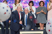 GOP Presidential candidate Donald Trump stands with running mate Gov. Mike Pence as balloons and confetti drop after accepting the party nomination for president on the final day of the Republican National Convention July 21, 2016 in Cleveland, Ohio.
