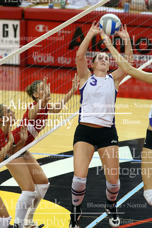 06 October 2007:  Kristin Belzung sets the ball close to the net. The Illinois State Redbirds pulled out a photo finish in a match that saw the 4th and 5th games extend into extra point play. Northern Iowa Panthers visited the Illinois State Redbirds at Redbird Arena on the campus of Illinois State University in Normal Illinois.