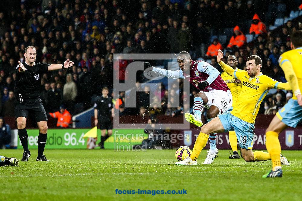 Christian Benteke of Aston Villa (centre)  shoots during the Barclays Premier League match at Villa Park, Birmingham<br /> Picture by Andy Kearns/Focus Images Ltd 0781 864 4264<br /> 01/01/2015