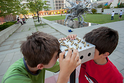 "United States, Washington, Bellevue, boys at ""Gazing Maze"" in  Bellwether 2012 outdoor sculpture exhibition in City Hall Plaza  MR"