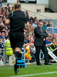 CARDIFF, WALES - Sunday, August 8, 2010: Cardiff City's Kenny Jackett stares out the assistant referee after the linesman disallowed a goal for off-side against Sheffield United during the League Championship match at the Cardiff City Stadium. (Pic by: David Rawcliffe/Propaganda)