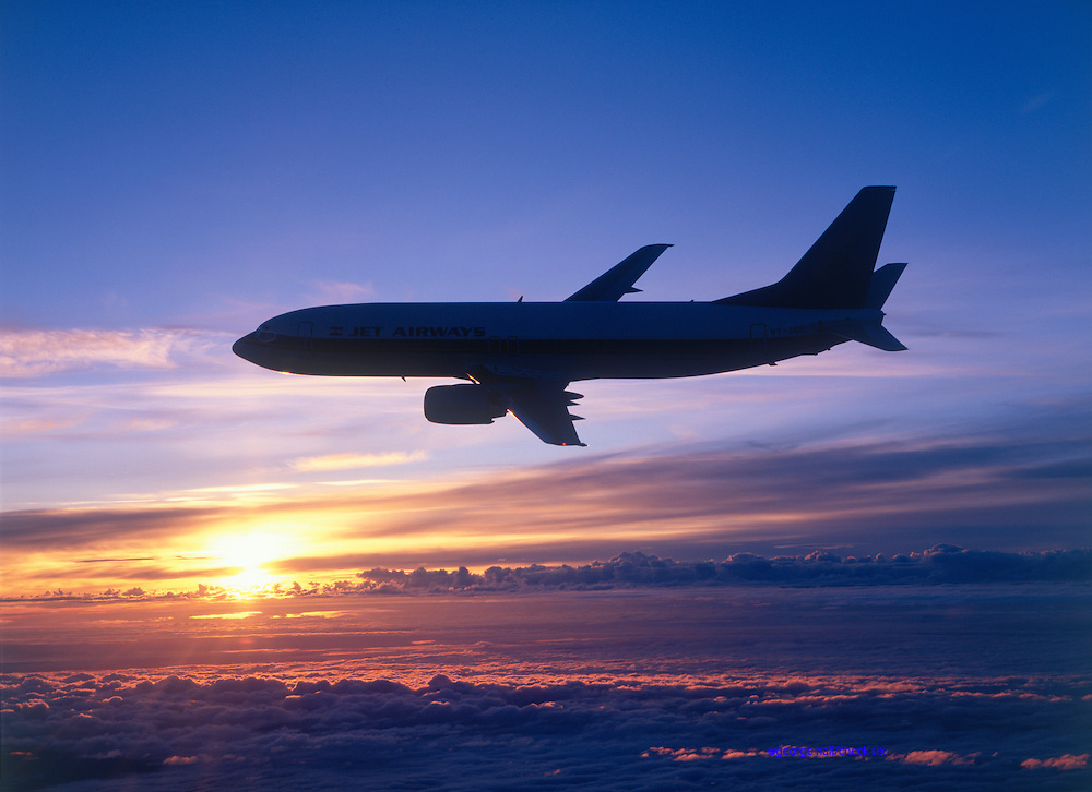 Boeing 737 in silhouette against the sunset