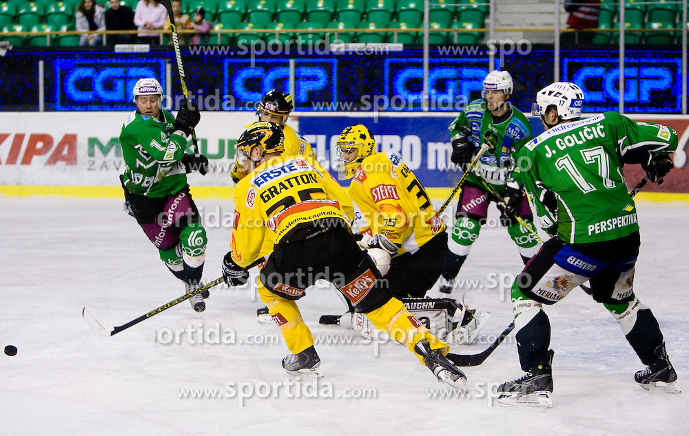 Matej Hocevar of Olimpija and Benoit Gratton of Vienna during 52nd Round of EBEL league ice-hockey match between HDD Tilia Olimpija, Ljubljana and EV Vienna Capitals, on February 7, 2010 in Arena Tivoli, Ljubljana, Slovenia. Vienna defeated Olimpija 8-2. (Photo by Vid Ponikvar / Sportida)