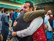 04 JUNE 2019 - DES MOINES, IOWA: Men greet each other after Eid al Fitr services in the Iowa Events Center in Des Moines Tuesday. About 3,000 people were expected to attend the annual community wide celebration of Eid al Fitr which marks the end of Ramadan, the Muslim month of fasting. According to the event organizers, there are about 15,000 Muslims in the Des Moines area.           PHOTO BY JACK KURTZ