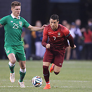 Cristiano Ronaldo, (right), Portugal, challenged by Jeff Hendrick, Ireland, during the Portugal V Ireland International Friendly match in preparation for the 2014 FIFA World Cup in Brazil. MetLife Stadium, Rutherford, New Jersey, USA. 10th June 2014. Photo Tim Clayton