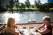Ginny Esposto, left, and Mary Ann Braunstein enjoy a drink on the deck of the Delta King, overlooking the Sacramento River in Old Sacramento.