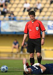 Enes Hasic and referee Matej Jugat 33rd Round of PrvaLiga Telekom Slovenije 2008/2009 league match between NK Luka Koper and NK Labod Drava Ptuj, on May 9, 2009, in SRC Bonifika, Koper, Slovenia. Drava won 2:1. (Photo by Vid Ponikvar / Sportida)