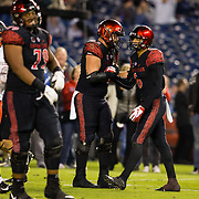 10 November 2018: San Diego State Aztecs wide receiver Tim Wilson Jr. (6) is congratulated by offensive lineman Nick Gerhard (62) after scoring on a 34 yard touchdown pass to give the Aztecs a 24-13 lead in the third quarter. The Aztecs lost 27-24 to UNLV Saturday night at SDCCU Stadium falling a game behind Fresno State in the conference standings.