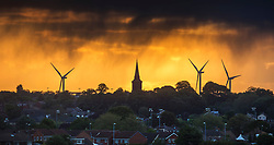 © Licensed to London News Pictures. 11/05/2020. Leeds UK. Rain falls from heavy clouds over St Mary's church at sunrise this morning in Garforth near Leeds, Yorkshire, as Britains heatwave seems to have ended with sun replaced by heavy cloud & wind. Photo credit: Andrew McCaren/LNP