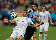 Luis Suarez of Uruguay and Phil Jagielka of England during the 2014 FIFA World Cup match at Arena Corinthians, Sao Paulo<br /> Picture by Andrew Tobin/Focus Images Ltd +44 7710 761829<br /> 19/06/2014