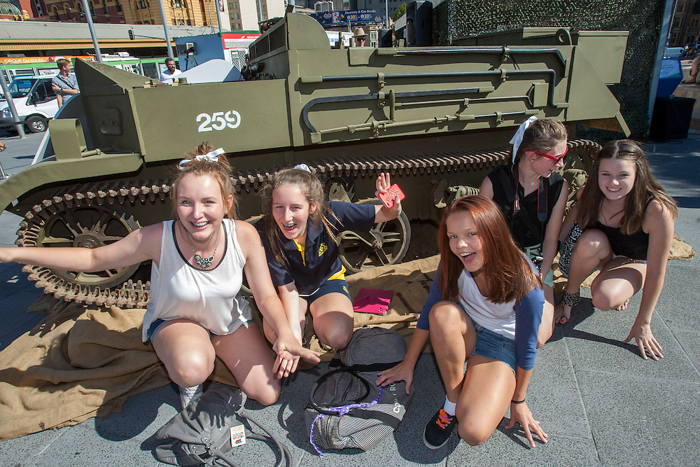 Three young stars show their support for the Fifth Army &amp; HeadSpace at an event at Federation Square. The three rode in an army style tank and signed up young followers to support the Fifth Army. .Singer song writer Sarah De Bono (with Red Hair).James Mason (in black shirt) aka Chris Pappas from TV show Neighbours.Trent &quot;Maxi&quot; Maxwell (White T-Shirt) Lifeguard from TV show Bondi Rescue.Photo By Craig Sillitoe This photograph can be used for non commercial uses with attribution. Credit: Craig Sillitoe Photography / http://www.csillitoe.com<br /> <br /> It is protected under the Creative Commons Attribution-NonCommercial-ShareAlike 4.0 International License. To view a copy of this license, visit http://creativecommons.org/licenses/by-nc-sa/4.0/. .