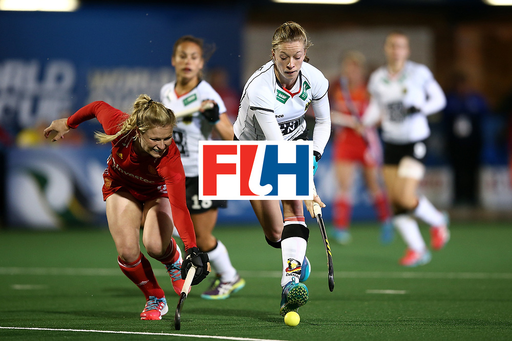 JOHANNESBURG, SOUTH AFRICA - JULY 14:  Hollie Webb of England battles with Franziska Hauke of Germany during day 4 of the FIH Hockey World League Women's Semi Finals Pool A match between Germany and England at Wits University on July 14, 2017 in Johannesburg, South Africa.  (Photo by Jan Kruger/Getty Images for FIH)