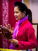 21 DECEMBER 2017 - HANOI, VIETNAM: A traditional musician performs in the Temple of Literature, a Confucian temple dedicated to learning and the humanities. It was also Vietnam's first national university. The temple was built in 1070 at the time of Emperor Lý Thánh Tông. It is one of several temples in Vietnam which is dedicated to Confucius, sages and scholars.   PHOTO BY JACK KURTZ