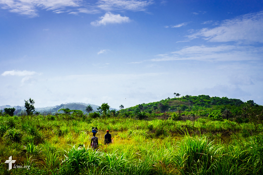 People walk through the land adjacent to the highway leading to Freetown on Saturday, May 12, 2018, in Sierra Leone, West Africa. LCMS Communications/Erik M. Lunsford