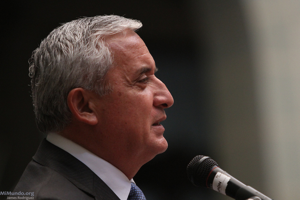 President Otto Perez Molina speaks during the signing of the official convene between the Guatemalan government and Tahoe Resources & Goldcorp's El Escobal silver project via its local subsidiary Minera San Rafael. The signing comes two days after six locals were shot by the company's security guards. Since 2011, eight local communities have carried out plebiscites that have rejected nearly unanimously the mining project in San Rafael Las Flores, Santa Rosa. Guatemala City, Guatemala. April 29, 2013.