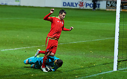 WREXHAM, WALES - Tuesday, November 17, 2015: Wales' Thomas O'Sullivan challenges for the ball with Romania's goalkeeper Laurentiu Branescu during the UEFA Under-21 Championship Qualifying Group 5 match at the Racecourse Ground. (Pic by David Rawcliffe/Propaganda)
