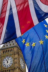 © Licensed to London News Pictures. 08/05/2017. London, UK. The flags of the United Kingdom and the EU seen in front of Big Ben, where The flags of all 27 EU members states (not al pictured) are currently flying around parliament Square, opposite the houses of Parliament in Westminster, London, ahead of Europe Day tomorrow (Tues). Europe Day marks the anniversary of Schuman declaration, which was the basis for the formation of the European Union. Photo credit: Ben Cawthra/LNP