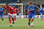 AFC Wimbledon striker Lyle Taylor (33) dribbling away from Charlton Athletic Anfernee Dijksteel (34)  during the The FA Cup match between AFC Wimbledon and Charlton Athletic at the Cherry Red Records Stadium, Kingston, England on 3 December 2017. Photo by Matthew Redman.