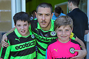 Forest Green Rovers Liam Noble(15) with the two mascots during the Vanarama National League match between Forest Green Rovers and Maidstone United at the New Lawn, Forest Green, United Kingdom on 22 April 2017. Photo by Shane Healey.