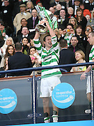 Aiden McGeady lifts the League Cup final after Celtic had wooon the final between Rangers and Celtic at Hampden Park -<br /> David Young