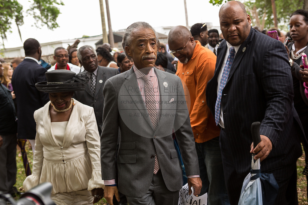 Rev. Al Sharpton greets gathered supporters following a peace vigil at the spot where unarmed motorist Walter Scott was gunned down by police April 12, 2015 in North Charleston, South Carolina. About 100 people showed up for the brief vigil following a healing service at Charity Mission Baptist Church.