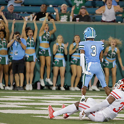Sep 19, 2019; New Orleans, LA, USA; Tulane Green Wave wide receiver Darnell Mooney (3) catches a touchdown over Houston Cougars safety Gervarrius Owens (32) during the third quarter at Yulman Stadium. Mandatory Credit: Derick E. Hingle-USA TODAY Sports