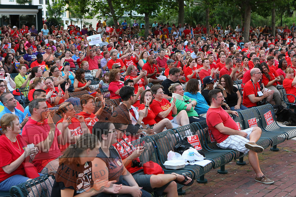 """People gather in Lake Eola park during the """"Marriage Equality Rally"""" at the Lake Eola bandshell in downtown Orlando, Florida on Thursday, June 27, 2013. Orlando's gay community and its supporters are celebrating the U.S. Supreme Court rulings on gay marriage and the Defense of Marriage Act (DOMA) reversal that constitutionally denied legally married gay couples federal benefits. (AP Photo/Alex Menendez)"""