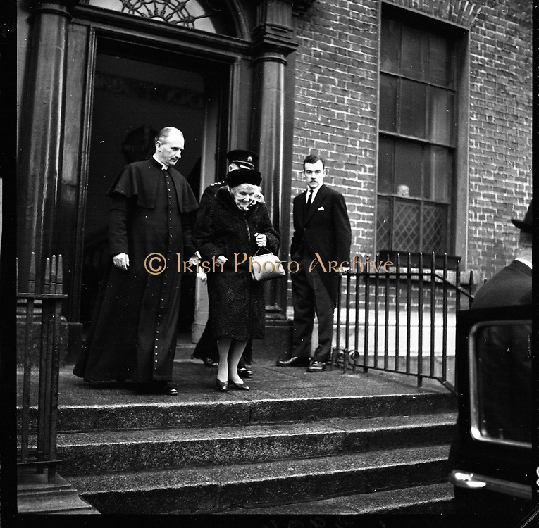 Ireland mourns President Kennedy. Thousands attended requiem Masses all over the country and businesses, schools and universities were closed. Mrs. De Valera, wife of the President, accompanied by the Reverend Fr. Patrick Murray and Col. Sean Brennan, Aide-de-Camp, leaving the Pro-Cathedral after the Mass..26.11.1963