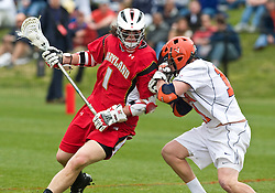 Maryland Terrapins Attack Grant Catalino (1) is defended by Virginia Cavaliers M George Huguely (11).  The #9 ranked Maryland Terrapins fell to the #1 ranked Virginia Cavaliers 10 in 7 overtimes in Men's NCAA Lacrosse at Klockner Stadium on the Grounds of the University of Virginia in Charlottesville, VA on March 28, 2009.