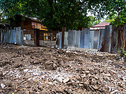 04 JULY 2017 - BANGKOK, THAILAND:   An empty lot that used to be a house in Pom Mahakan. The final evictions of the remaining families in Pom Mahakan, a slum community in a 19th century fort in Bangkok, have started. An ad hoc group of housing advocates, historic preservationists and academics have asked the city to allow the remaining residents to stay and city officials have said they might allow people who can prove that their families have lived in the fort since before the 1950s, when the city got title to the land from the Thai military, will be able to stay.   PHOTO BY JACK KURTZ
