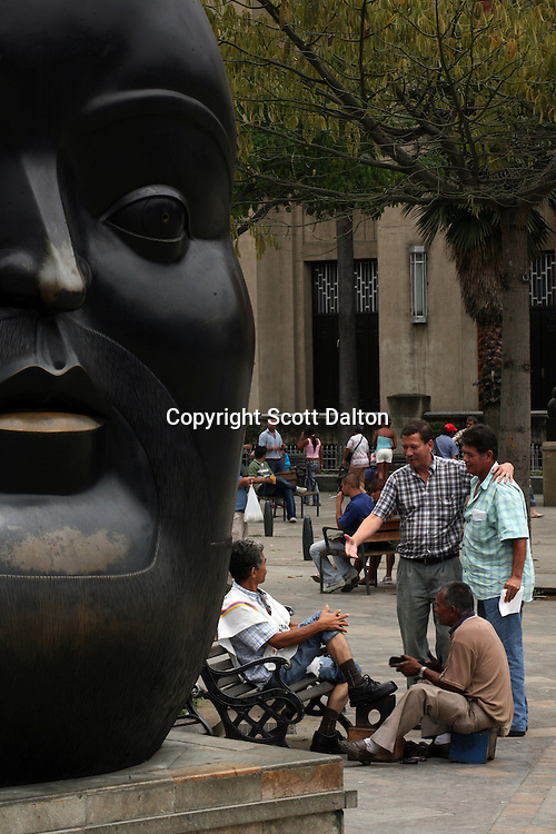 Men gather to talk in the Plaza Botero, in downtown Medellin on May 19, 2007. (Photo/Scott Dalton)