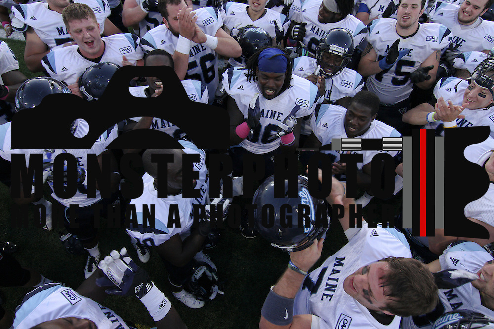 University of Maine players celebrate a Week 6 victory over 15th rank Delaware Saturday. Oct 6. 2012, at Delaware stadium in Newark Delaware.
