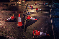 Traffic bollards tipped over on a wet London street in Woolwich. One way, or another, I'm gonna find ya...