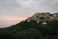 """PISCIOTTA, ITALY - 21 APRIL 2018: A view of the historical center of Pisciotta, Italy, on April 21st 2018.<br /> <br /> Former restaurant owners Donatella Marino and her husband Vittorio Rimbaldo have spent the recent years preparing and selling salted anchovies, called alici di menaica, to a growing market thanks to a boost in visibility from the non-profit Slow Food.  The ancient Menaica technique is named after the nets they use brought by the Greeks wherever they settled in the Mediterranean. Their process epitomizes the concept of slow food, and involves a nightly excursion with the special, loose nets that are built to catch only the larger swimmers. The fresh, red anchovies are immediately cleaned and brined seaside, then placed in terracotta pots in between layers of salt, to rest for three months before they're aged to perfection.While modern law requires them to use PVC containers for preserving, the government recently granted them permission to use up to 10 chestnut wood barrels for salting in the traditional manner. The barrels are """"washed"""" in the sea for 2-3 days before they're packed with anchovies and sea salt and set aside to cure for 90 days. The alici are then sold in round terracotta containers, evoking the traditional vessels that families once used to preserve their personal supply.<br /> <br /> Unlike conventional nets with holes of about one centimeter, the menaica, with holes of about one and half centimeters, lets smaller anchovies easily swim through. The point may be to concentrate on bigger specimens, but the net also prevents overfishing."""