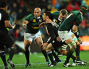 Andries Bekker tackles Dan Carter as he passes across Gurthro Steenkamp to Sione Lauaki.<br /> Philips Tri Nations, All Blacks vs South Africa at Westpac Stadium, Wellington, New Zealand, Saturday 5 July 2008. Photo: Dave Lintott/PHOTOSPORT