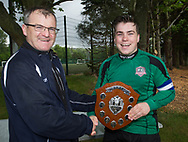 FC Kettledrum captain Cammy Johnstone is presented with the Dundee Saturday Morning Football League first division championship trophy by league president Steve McSwiggan at University Grounds, Riverside<br /> <br /> <br />  - &copy; David Young - www.davidyoungphoto.co.uk - email: davidyoungphoto@gmail.com