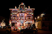 "A few blocks away from the main attractions is this house, with ""Merry Christmas"" as well as the Greek ""Kala Xpistouyevva"""