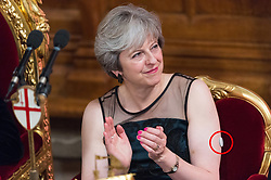 © Licensed to London News Pictures. 13/11/2017. London, UK. British Prime Minister THERESA MAY swears a glucose monitor (circled in red ) on her left arm as she attends the annual Lord Mayor's Banquet at Guildhall. Mrs May was diagnosed<br /> with type 1 diabetes in 2012. Photo credit: Ray Tang/LNP