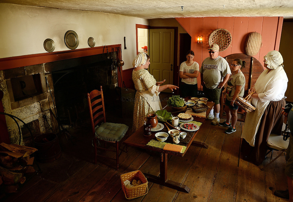 7/4/16 :: REGION :: STRASZHEIM :: Natalie Livington explains colonial cooking to guests touring the Nathan Lester House as the Ledyard Historical Society hosts an Old-Fashioned Independence Day Celebration Monday, July 4, 2016 at the Nathan Lester House and Farm Tool Museum. (Sean D. Elliot/The Day)