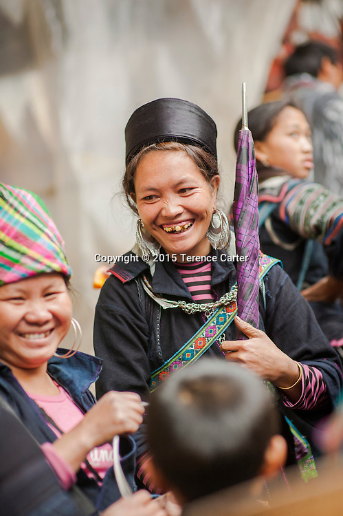 A hilltribe woman with her distictive outfit in the markets in Sapa, Vietnam.