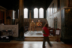 UK ENGLAND LONDON 5MAY12 - Visitors admire the De Brecy Tondo artwork, suspected to be by Reniassance painter Rafael is on display at the Westminster Cathedral in central London...The Tondo displays striking resemblance to Rafael's Sistine Madonna, finished as a commissioned altarpiece and the last painting he completed with his own hands a few years before his death...Relocated to Dresden from 1754, the well-known painting has been particularly influential in Germany...jre/Photo by Jiri Rezac....© Jiri Rezac 2012