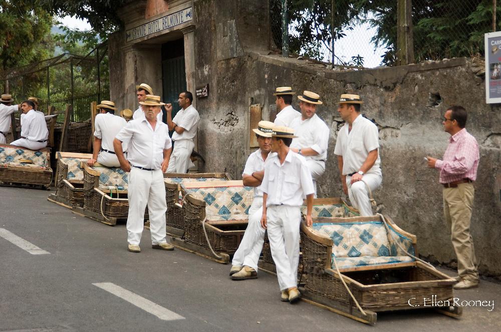 Toboggan drivers waiting for tourists at the Monte toboggan run.  Madeira, Portugal