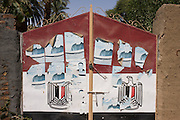 Local election posters and the colours of the national flag on the gates of a home near the ancient Egyptian site of Medinet Habu, Luxor, Nile Valley, Egypt.