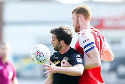 Will Grigg of Wigan Athletic takes on Cian Bolger of Fleetwood Town- Mandatory by-line: Robbie Stephenson/JMP - 21/04/2018 - FOOTBALL - Highbury Stadium - Fleetwood, England - Fleetwood Town v Wigan Athletic - Sky Bet League One