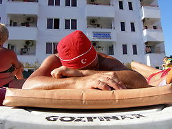 English holidaymaker sunbathing in hotel Marmaris Turkey